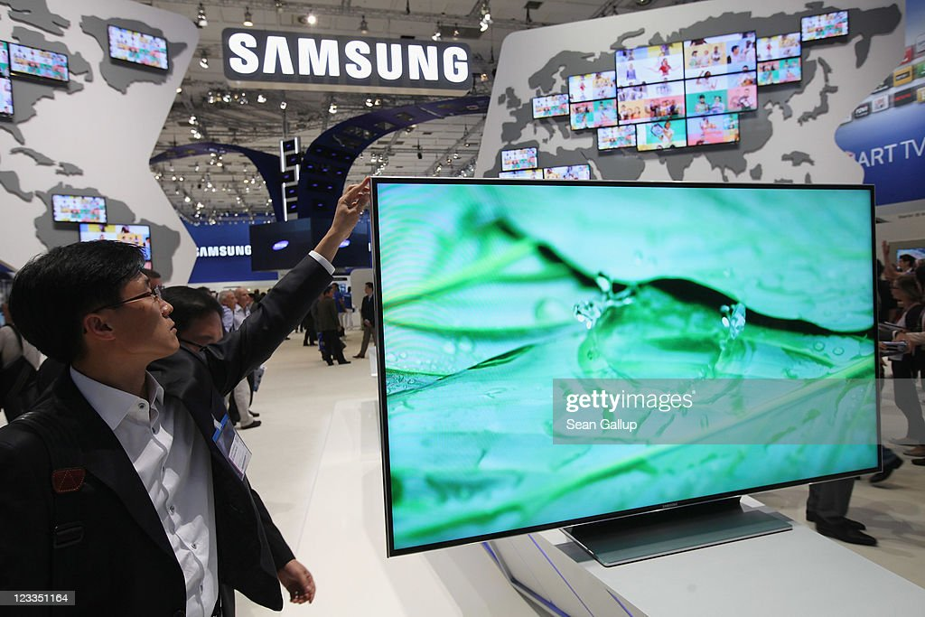 A visitor checks out a Samsung Smart TV television at the Samsung hall at the IFA 2011 consumer electonics and appliances trade fair on the first day of the fair's official opening on September 2, 2011 in Berlin, Germany. The IFA 2011 will be open to the public from September 2-7.