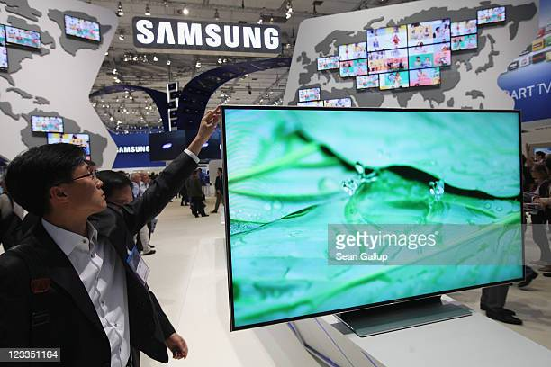 A visitor checks out a Samsung Smart TV television at the Samsung hall at the IFA 2011 consumer electonics and appliances trade fair on the first day...