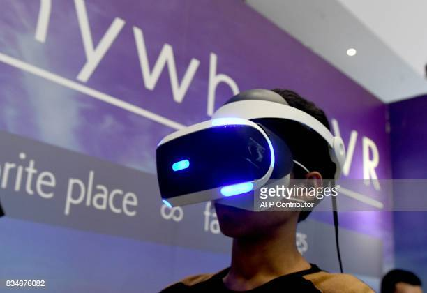 A visitor checks out a Virtual Reality game at the Anime Festival Asia in Jakarta on August 18 2017 Anime short for animation in Japanese is now a...