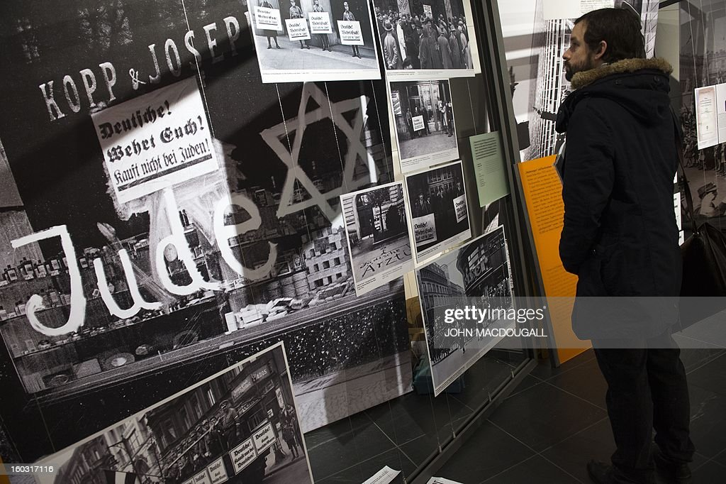 A visitor checks out the exhibition 'Berlin 1933 – The Road to Dictatorship' at the Topography of Terror museum in Berlin January 29, 2013. The exhibition highlights key points up until the Summer of 1933. At the same time, it displays victims' biographies within the early stages of NS-Terror, in the months after 30th January 1933. The exhibition coincides with the 80th anniversary of Adolf Hitler's accession to power January 30, 1933. AFP PHOTO / JOHN MACDOUGALL