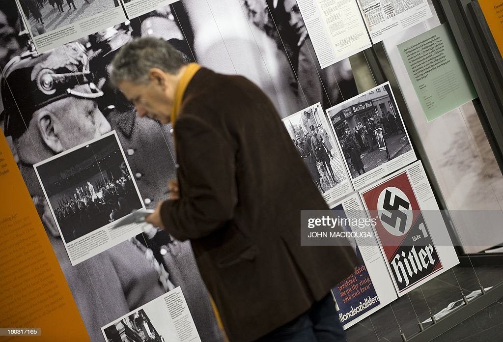 A visitor checks out the exhibition 'Berlin 1933 – The Road to Dictatorship' at the Topography of Terror museum in Berlin January 29, 2013. The exhibition highlights key points up until the Summer of 1933. At the same time, it displays victims' biographies within the early stages of NS-Terror, in the months after 30th January 1933. The exhibition coincides with the 80th anniversary of Adolf Hitler's accession to power January 30, 1933.