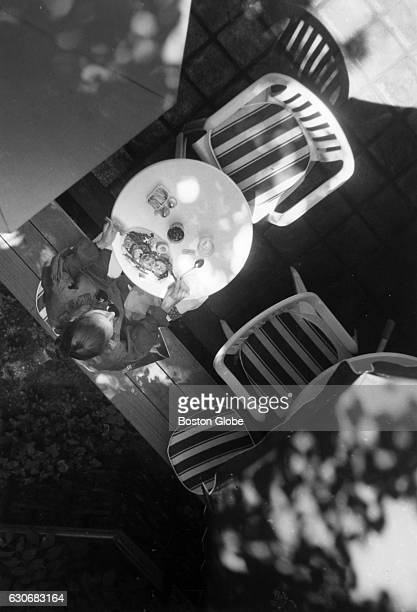A visitor dines outside at the Isabella Stewart Gardner Museum's cafe 1993