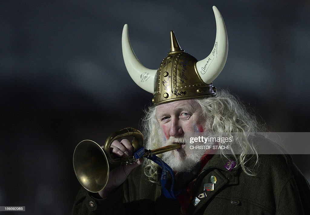 A visitor dressed as a Viking blows in his horn during the 10 km men Biathlon World Cup sprint competition on January 12, 2013, in Ruhpolding, southern Germany. French Martin Fourcade won the competition, Russia's Evgeny Ustyugov placed secod and Russia's Andrei Makoveev placed third. AFP PHOTO/CHRISTOF STACHE