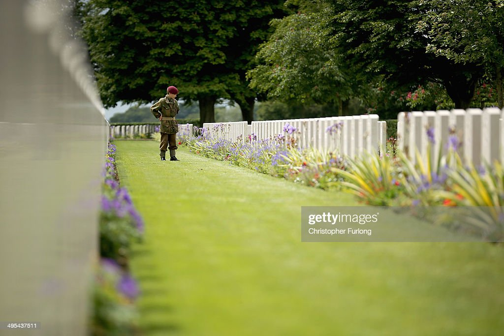 A visitor dressed in WWII period uniform views the graves of fallen soldiers at The Bayeux War Cemetery on June 3, 2014 in Bayeux, France. The Bayeux War Cemetery is the largest WWII cemetery of Commonwealth soldiers in France and contains 4,648 graves of the fallen. Friday 6th June is the 70th anniversary of the D-Day landings which saw 156,000 troops from the allied countries including the United Kingdom and the United States join forces to launch an audacious attack on the beaches of Normandy, these assaults are credited with the eventual defeat of Nazi Germany. A series of events commemorating the 70th anniversary are planned for the week with many heads of state travelling to the famous beaches to pay their respects to those who lost their lives.
