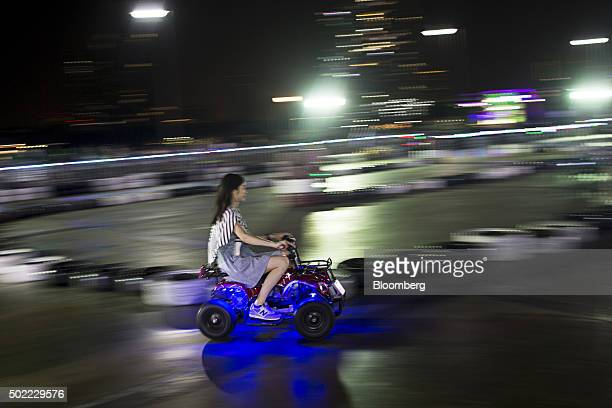 A visitor drives a gokart at Asiatique The Riverfront openair mall in Bangkok Thailand on Friday Dec 18 2015 Thai economic indicators have shown...