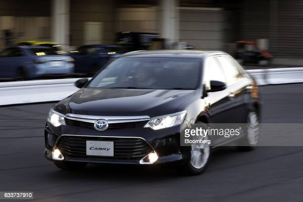 A visitor drives a Toyota Motor Corp Camry vehicle during a test drive at the company's Mega Web car theme park in Tokyo Japan on Friday Feb 3 2017...