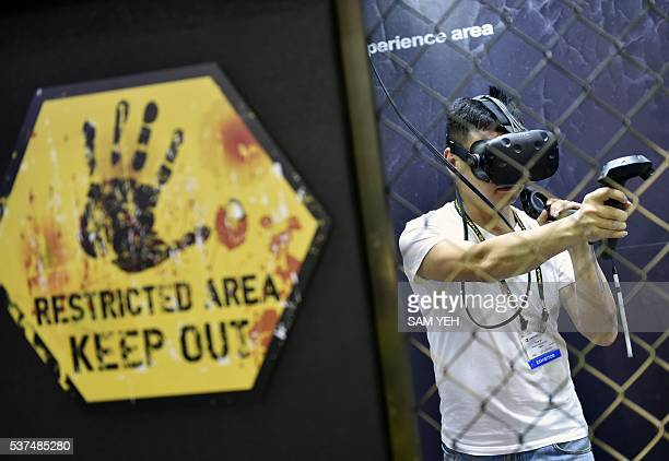 A visitor enjoys the HTC Vive visual reality headset during the annual Computex computer show in Taipei on May 31 2016 Reducing errors made during...
