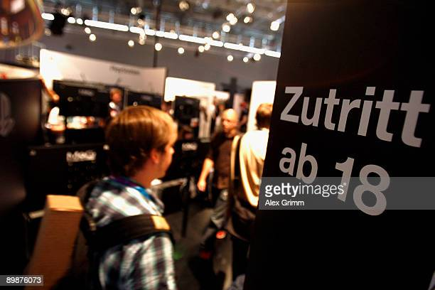 A visitor enters the adults area at the Playstation stand of Japanese electronic corporate Sony during the 'gamescom' Europe's biggest trade fair for...