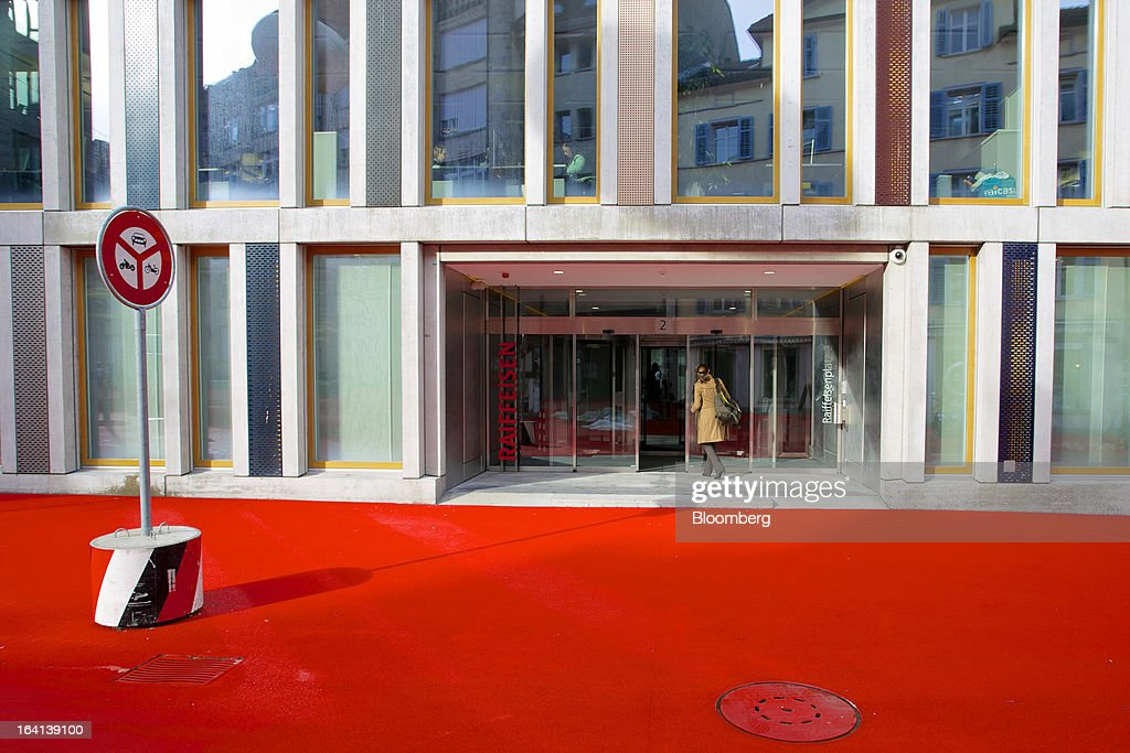 A visitor enters the headquarters of Raiffeisen Group in St. Gallen, Switzerland, on Wednesday, March 20, 2013. Wegelin & Co., who sold Notenstein Privatbank AG to Raiffeisen Group last year, were ordered to pay U.S. authorities almost $58 million at the end of a criminal case after the Swiss bank pleaded guilty to helping American taxpayers hide more than $1.2 billion from the Internal Revenue Service. Photographer: Gianluca Colla/Bloomberg via Getty Images