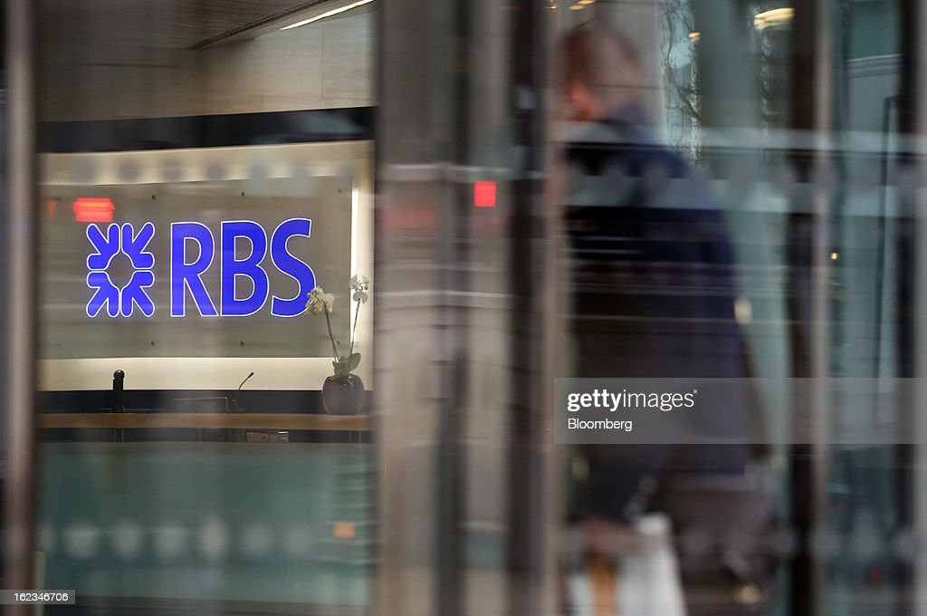 A visitor enters the headquarters of Royal Bank of Scotland Group Plc (RBS) in London, U.K., on Friday, Feb. 22, 2013. RBS, Britain's biggest publicly owned lender, was fined $612 million by regulators in the U.K. and the U.S. for rigging the London interbank offered rate and similar benchmarks. Photographer: Chris Ratcliffe/Bloomberg via Getty Images