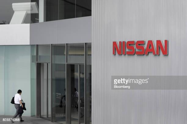A visitor enters the Nissan Motor Co showroom in Yokohama Japan on Thursday July 27 2017 Nissan is counting on SUV models and the new Leaf to drive...