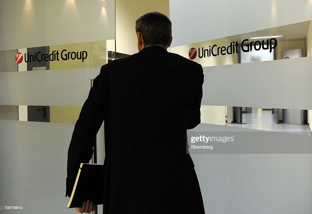 A visitor enters the UniCredit SpA headquarters in Milan, Italy, on Friday, May 21, 2010. UniCredit SpA Chief Executive Officer Alessandro Profumo said that contagion from Greece's debt crisis will be managed and that Europe should concentrate on growth and not just cutting public debt. Photographer: Giuseppe Aresu/Bloomberg via Getty Images