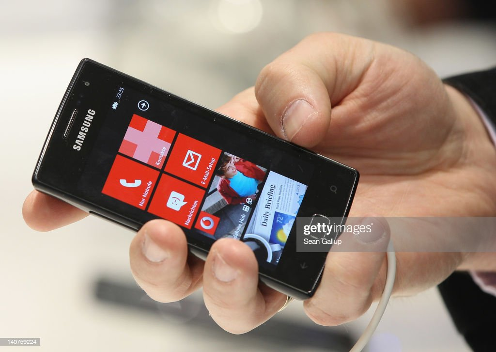 A visitor examines a Samsung smartphone with a Microsoft operating system on the first day of the CeBIT 2012 technology trade fair on March 6, 2012 in Hanover, Germany. CeBIT 2012, the world's largest information technology trade fair, will run from March 6-10, and advances in cloud computing and security are major features this year.