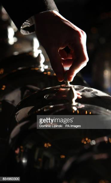 A visitor examines a set of silver plated cloches as part of the closing down auction at the Cafe Royal Piccadilly London