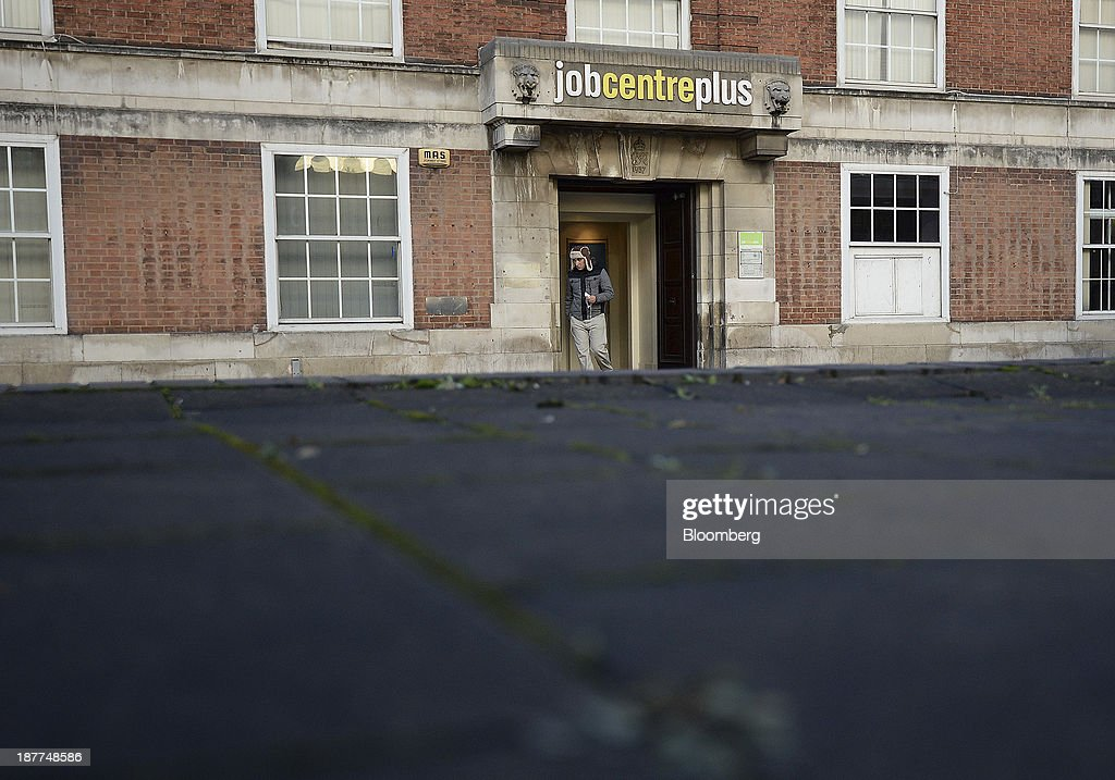 A visitor exits a job centre in Leeds, U.K., on Tuesday, Nov. 12, 2013. Under Bank of England Governor Mark Carney's forward-guidance policy, the central bank has pledged to not to withdraw stimulus at least until unemployment falls to 7 percent. Photographer: Nigel Roddis/Bloomberg via Getty Images
