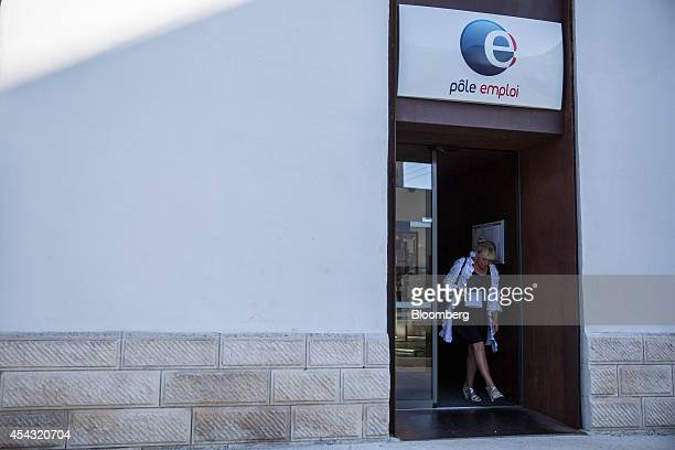 A visitor exits a Pole Emploi job center the French national employment agency in Cahors France on Thursday Aug 28 2014 French jobless claims rose to...