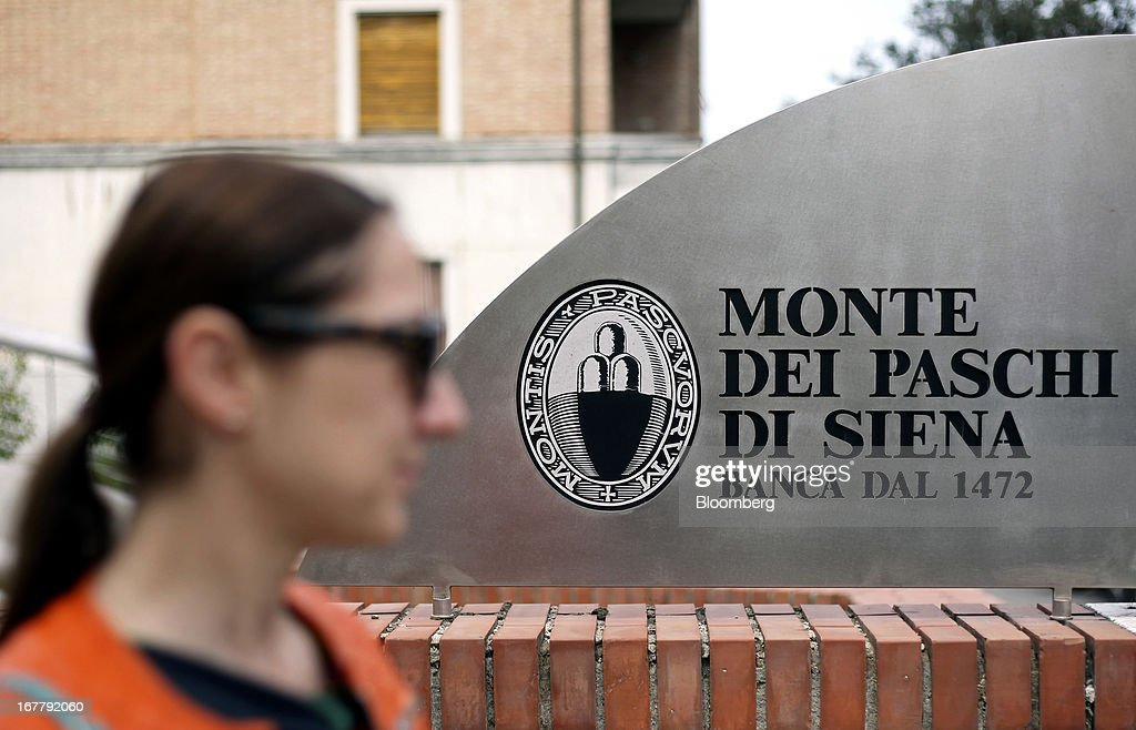 A visitor exits Banca Monte dei Paschi di Siena SpA's administrative offices in Siena, Italy, on Monday, April 29, 2013. An Italian judge rejected a request by prosecutors to seize as much as 1.95 billion euros ($2.5 billion) of assets held by Nomura Holdings Inc. as they probed how Banca Monte dei Paschi di Siena SpA used derivatives to conceal losses. Photographer: Alessia Pierdomenico/Bloomberg via Getty Images