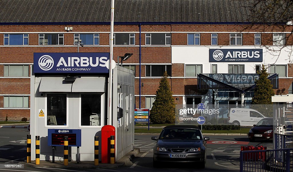 A visitor exits the Airbus wing assembly factory in Broughton, U.K., on Monday, Feb. 4, 2013. Airbus SAS won a $9 billion order from Steven Udvar-Hazy's Air Lease Corp. that includes 25 A350 wide-body jets, a competitor to Boeing Co.'s grounded 787 Dreamliner. Photographer: Paul Thomas/Bloomberg via Getty Images