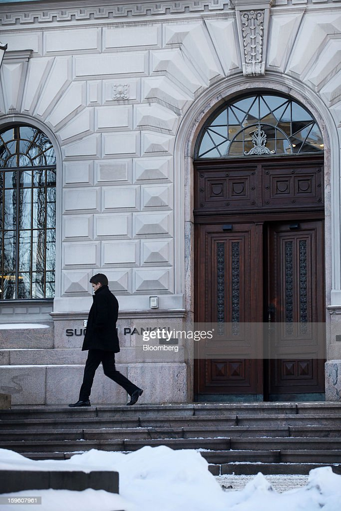 A visitor exits the Finnish central bank in Helsinki, Finland, on Thursday, Jan. 17, 2013. The pace of Finland's debt growth is alarming and the country must undertake economic reforms together with reining in spending, Finnish Prime Minister Jyrki Katainen said in an op-ed piece published in newspaper Savon Sanomat. Photographer: Ville Mannikko/Bloomberg via Getty Images