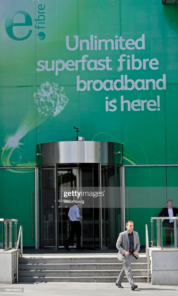 A visitor exits the headquarters of Eircom Group in Dublin, Ireland, on Thursday, May 23, 2013. Eircom Group, which has changed ownership six times since 1999, 'would like to be consolidators rather than consolidated' amid expected mergers and acquisitions in the Irish telecoms market, its Chief Financial Officer Richard Moat said. Photographer: Aidan Crawley/Bloomberg via Getty Images