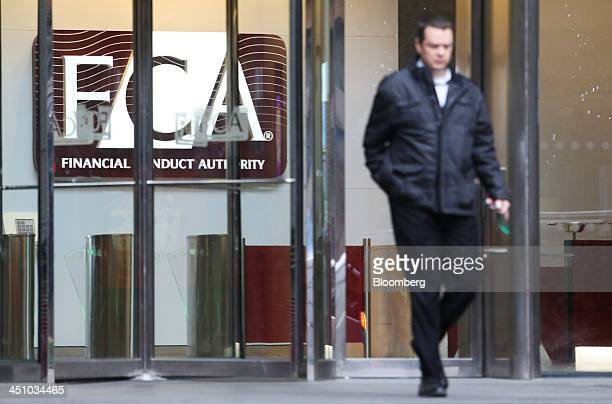 A visitor exits the headquarters of the Financial Conduct Authority in the Canary Wharf business district in London UK on Thursday Nov 21 2013 The...