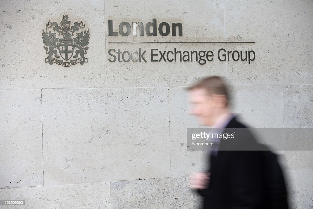 A visitor exits the London Stock Exchange Group Plc's (LSE) headquarters in London, U.K., on Monday, March 11, 2013. European stocks fell from a 4 1/2-year high as Fitch Ratings downgraded Italy and China's retail sales and industrial output missed forecasts. Photographer: Jason Alden/Bloomberg via Getty Images