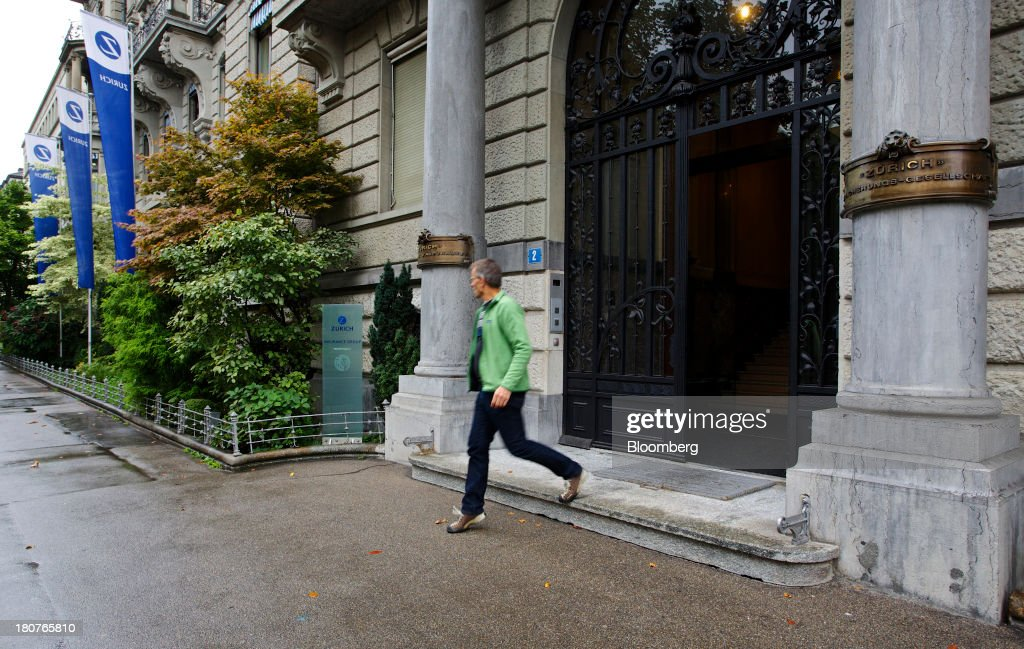 A visitor exits Zurich Insurance Group AG's headquarters in Zurich, Switzerland, on Monday, Sept. 16, 2013. Zurich Insurance named Tom de Swaan chairman, replacing Josef Ackermann, who stepped down after the suicide of Chief Financial Officer Pierre Wauthier. Photographer: Gianluca Colla/Bloomberg via Getty Images