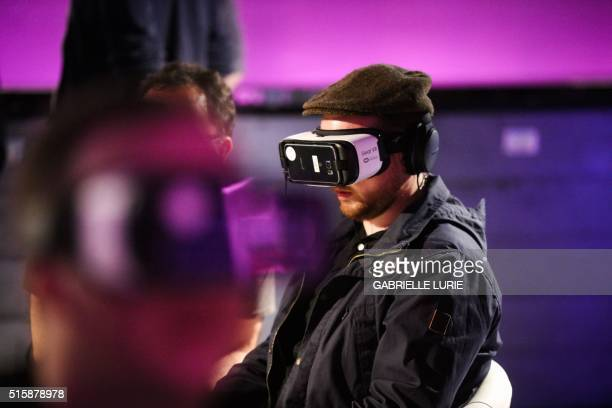 A visitor experiences Minecraft for Gear VR while wearing Oculus goggles during demonstration of the Minecraft for VR Gear at The Village event space...