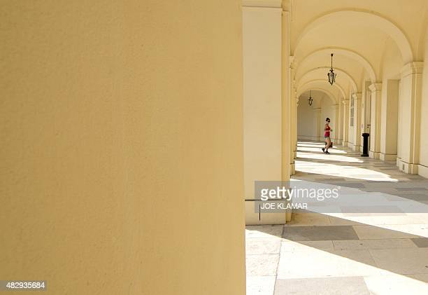 A visitor explores the grounds of Schoenbrunn palace in Vienna on August 4 2015 Schoenbrunn Palace is a former imperial summer residence located in...