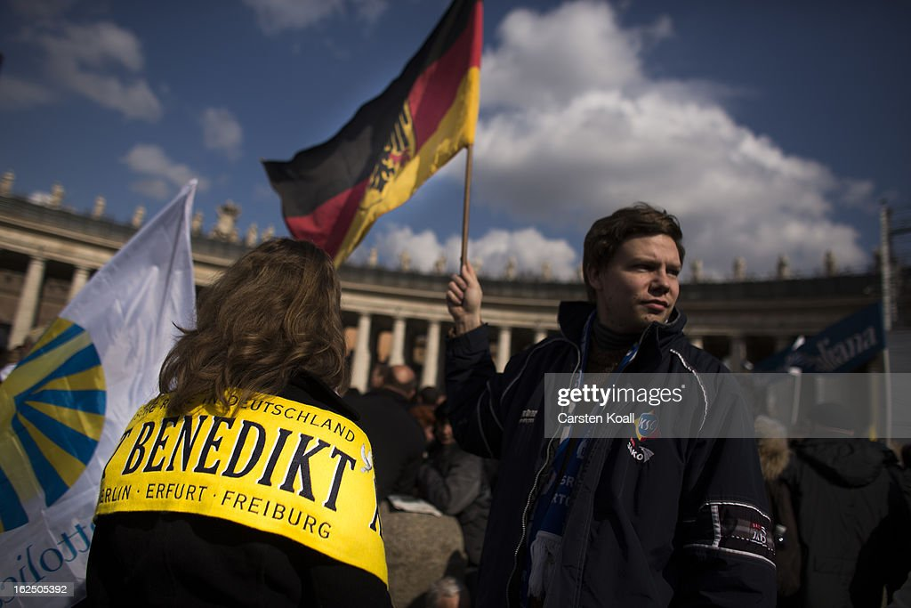 A visitor from germany wears a banner reading 'Benedict' beside a man holding a german flag on February 24, 2013 in Vatican City, Vatican. Pope Benedict XVI delivers his last Angelus Blessing from the window of his private apartment to thousands of pilgrims gathered in Saint Peter's Square on February 24, 2013 in Vatican City, Vatican. The Pontiff will hold his last weekly public audience on February 27, 2013 before he retires the following day. Pope Benedict XVI has been the leader of the Catholic Church for eight years and is the first Pope to retire since 1415. He cites ailing health as his reason for retirement and will spend the rest of his life in solitude away from public engagements.