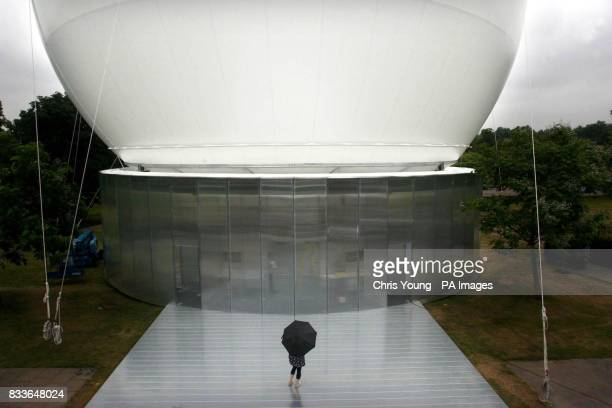 A visitor gazes up at the new inflatable canopy at the Serpentine Gallery Hyde Park London