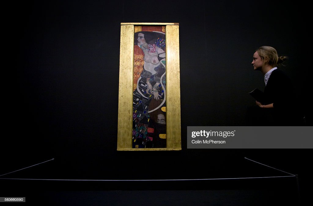 A visitor getting a preview of 'Judith II ' part of 'Gustav Klimt Painting Design and Modern Life in Vienna 1900' Exhibition at the Tate Liverpool