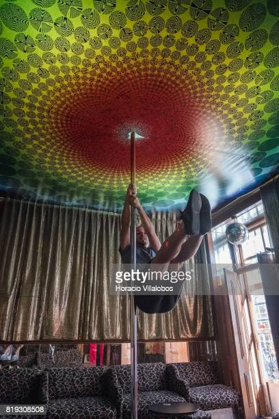 A visitor gives it a try in the pole dancing room at 'Pensao Amor' on July 14 2017 in Lisbon Portugal 'Pensao Amor' used to be a five floors brothel...