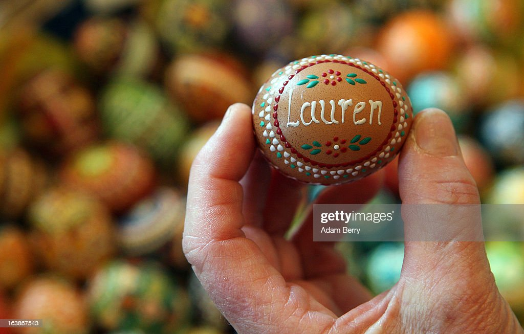 A visitor holds a decorated Easter egg with her granddaughter's name that she has just purchased at the annual Easter egg market on March 16, 2013 in Schleife, Germany. Easter is a particularly important time of year for Sorbs, a Slavic minority in eastern Germany, and the period includes the tradition of painting Easter eggs that include visual elements intended to ward off evil. Many Sorbs still speak Sorbian, a language closely related to Polish and Czech.