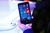 A visitor holds a new Windows Lumia 640 XL smartphone in the Microsoft Corp pavilion at the Mobile World Congress in Barcelona Spain on Monday March...
