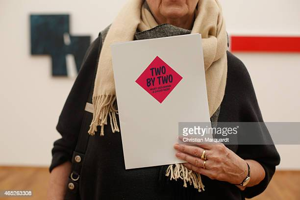 Visitor holds a press map 'Two By Two' during the 'Two By Two' exhibition at Hamburger Bahnhof on March 5 2015 in Berlin Germany 'Two By Two' marks...