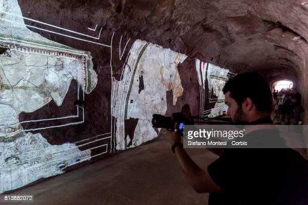 Visitor in front of a wall bearing a projection in the Criptoportico Neroniano a tunnel in the Palatino Hill in the Ancient Roman Forum during a...