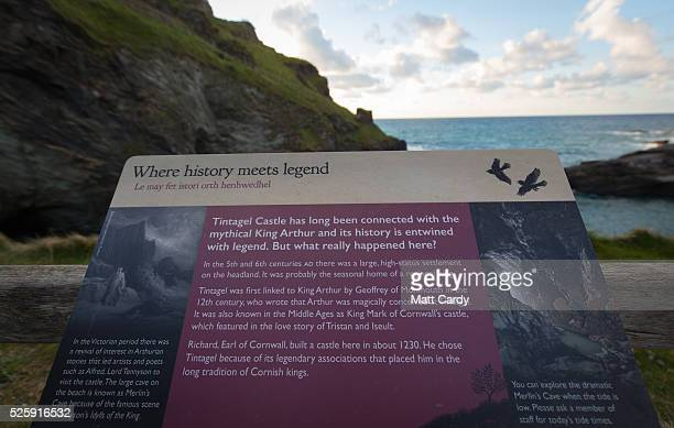 A visitor information board is displayed at Tintagel Castle on April 27 2016 in Cornwall England The English Heritage managed site and the nearby...