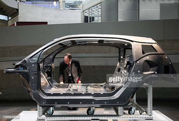 A visitor inspects a carbon fibre car chassis on display at the Bayerische Motoren Werke AG auto plant in Leipzig Germany on Friday Nov 5 2010...