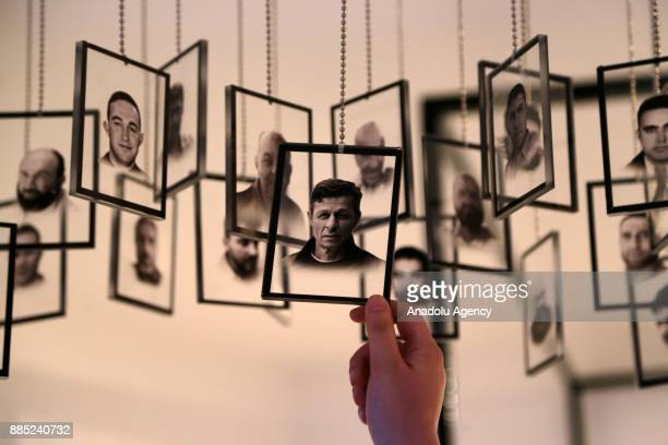 A visitor inspects the photos of martyrs who were martyred during the defeated 15th of July 2016 coup attempt at the 'July 15 Democracy Museum' built...
