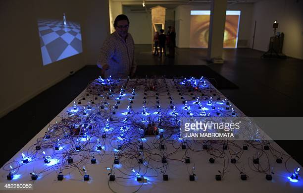 A visitor interacts with 'Game of Life' an installation by Argentine artist Leo Nunez at the Borges Cultural Centre in Buenos Aires on July 29 2015...