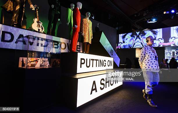 A visitor is pictured at the exhibition 'David Bowie is' at the Groninger Museum in Groningen on January 8 2016 More than 300 objects have been...
