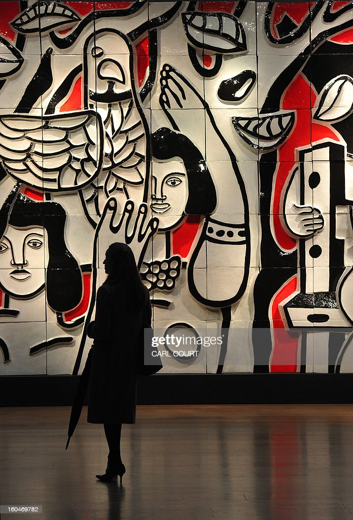 A visitor is pictured in front of a work entitled 'Les femmes au perroquet' and created after a design by French artist Fernand Leger at Christies auction house in central London on February 1, 2013. Due to form part of the Impressionist and Modern Art Evening Sale on February 6, it is expected to fetch between 300,000-500,000 GBP (460,000-750,000 USD - 340,000-560,000 EUR).