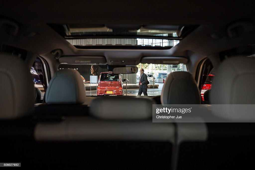 A visitor is seen through the interior of a Nissan vehicle displayed at the company's showroom on February 10, 2016 in Tokyo, Japan. Nissan Motor Co., Ltd., announced the financial results for the third quarter of fiscal year 2015 ending March 31, 2016. The net revenues resulted in 8.9430 trillion yen, the operating profit, 587.5 billion yen, and the net income 452.8 billion yen, For the April-December 2015 period, Nissan sold a total of 3,891,000 vehicles globally.