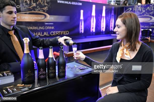 A visitor is served Halal champagne during the Oriental Wedding Fair in Paris on November 17 2012 The event runs until November 18 AFP PHOTO / MEHDI...