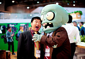 INFO A visitor jokes with a disguised fair host during the 2014 Mobile World Congress in Barcelona on February 27 2014 The Mobile World Congress runs...