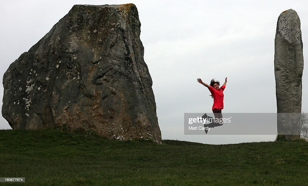 A visitor jumps as she poses for a photograph besides the Neolithic stones at Avebury on February 7, 2013 in Wiltshire, England. A leading travel magazine has recently named the collection of stones - thought to have been constructed around 2600BC and the largest stone circle in Europe, as the second best heritage site in the world. The Wiltshire world heritage site has been placed ahead of much more recognisable sites including the Valley of the Kings in Egypt, Taj Mahal in India and the Forbidden City in China.