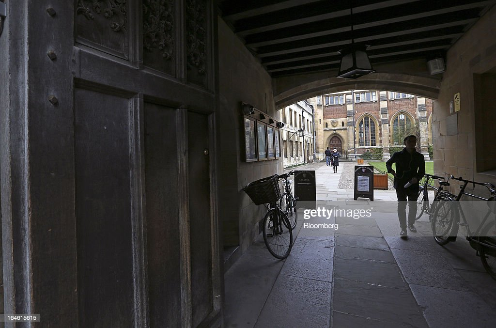 A visitor leaves Pembroke College, part of the University of Cambridge, in Cambridge, U.K., on Friday, March 22, 2013. In 2011, the U.K.'s government unveiled a plan to reduce state spending on higher education and shift more of the costs to students through tuition increases and a loan program. Photographer: Chris Ratcliffe/Bloomberg via Getty Images