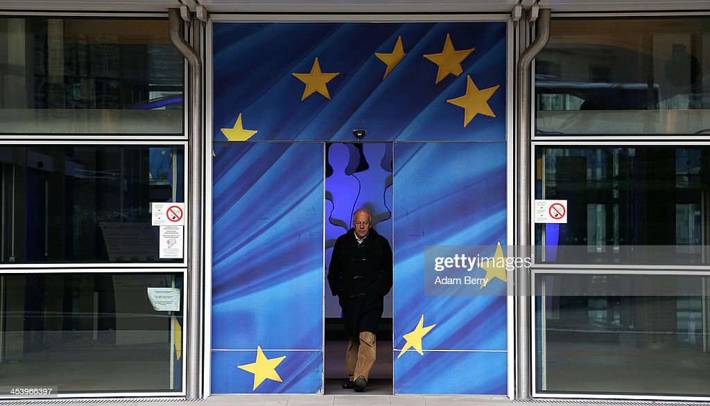 A visitor leaves the Berlaymont building of the European Commission (EC) on December 6, 2013 in Brussels, Belgium. The European Commission is responsible for the implementation and maintenance of the execution of the European Union's policies.