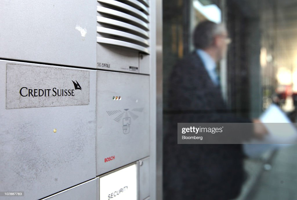 A visitor leaves the Credit Suisse Group AG German headquarters in Frankfurt, Germany, on Wednesday, July 14, 2010. Credit Suisse Group AG's offices in Germany were searched today in a probe into allegations that its employees may have helped clients evade taxes. Photographer: Hannelore Foerster/Bloomberg via Getty Images